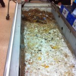 Cleaning underneath the conveyer belt at a till in a UK supermarket. GROSS!!!!!!!