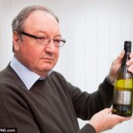 Businessman's shock at finding huge poisonous spider floating in a Tesco bottle of white wine