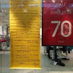 PISSED OFF WET SEAL EMPLOYEES HANG SIGN IN STORE WINDOW EXPOSING THEIR TERRIBLE COMPANY